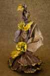 Martinique Female Plastic Doll with Clothing Made with Banana Leaves That Is Highlighted with Gold Paint (Three Quarter View)