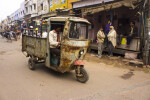Men Driving a Tuk Tuk