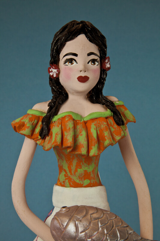 Mexico Ceramic Doll with Red Flowers in Her Long Black Hair (Close Up)