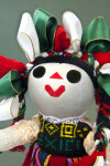 Mexico Cloth Doll with Felt Pieces for Facial Features and Colorful Ribbons in Her Hair (Close Up)