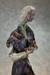 Mexico Handcrafted Figure of Woman Holding a Piece of Clay (Profile View)