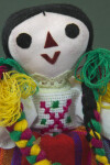 Mexico Jointed Doll with Felt Facial Features and Colorful Yarn Braids (Close Up)