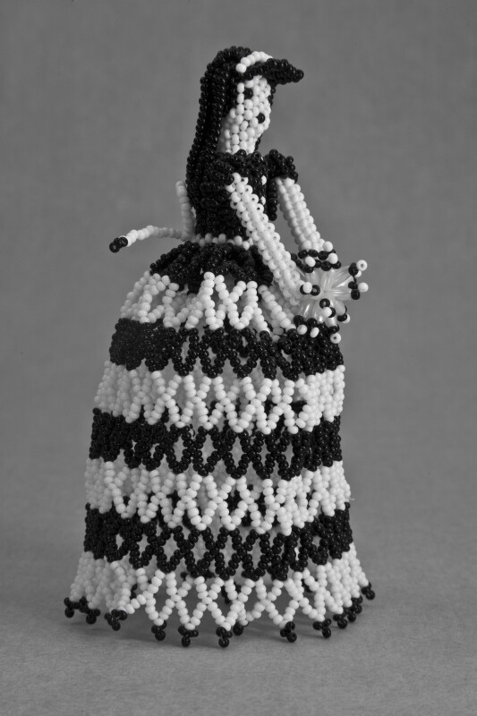 Mexico Lady Made from Beads Wearing Full Skirt and Holding Bouquet (Three Quarter View)