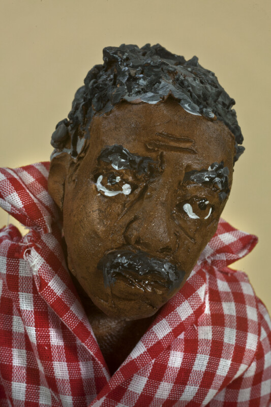 Mississippi Handcrafted Old Man Made from Mud Collected from the Mississippi River Banks (Close Up)
