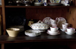 Mixed Dinnerware on Shelves