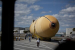 NASA Employees Moving Tank