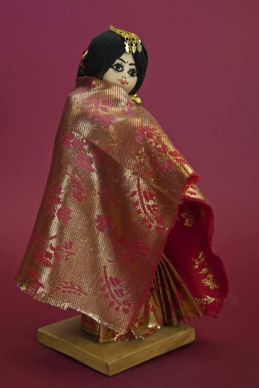 Nepal Doll with Traditional Wedding Costume for Newari Bride with Gold Head Ornament (Three Quarter View)