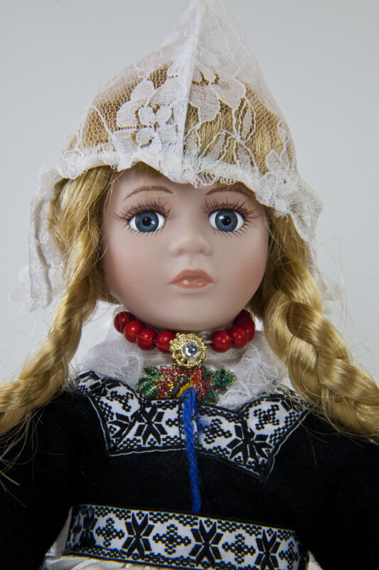 Netherlands Doll Wearing Traditional Peaked Dutch Cap Made of Lace (Close Up)