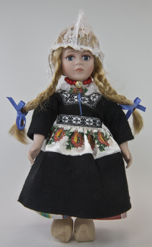 Netherlands Dutch Girl Wearing Braids and  Traditional Lace Peaked Cap (Full View)
