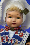 Netherlands Female Doll Wearing Traditional Large White Cap and Colorful Kraplap (Close Up)