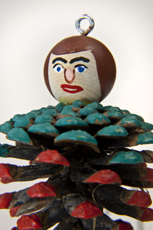 New Brunswick Handcrafted Male Doll with Painted Pinecone Body (Close Up)