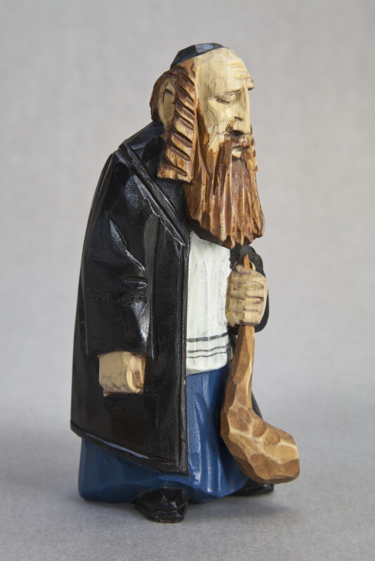 New York Handcrafted Wood Carving of Rabbi Holding a Shofar (Three Quarter View)