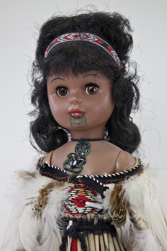 New Zealand Maori Indian Doll Wearing Feather Shawl and Green Hei-tiki Pendant (Close Up)