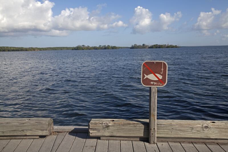 No Fishing Sign on Boardwalk Overlooking Water