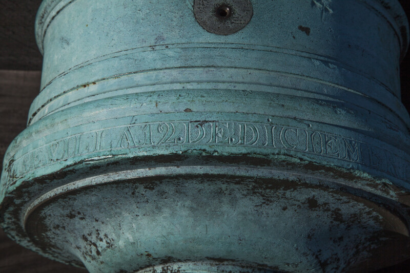 Numbers and Letters Engraved into an Oxidized, Bronze Cannon