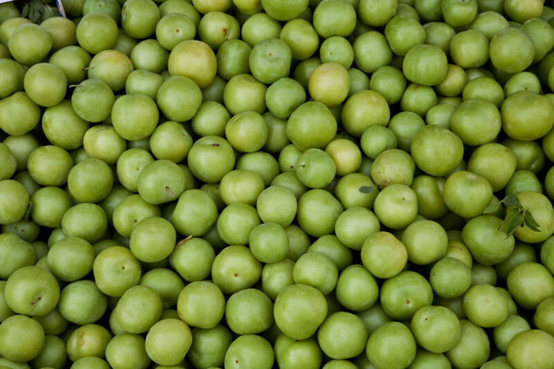 Numerous Green Apples on Display at an Outdoor Market