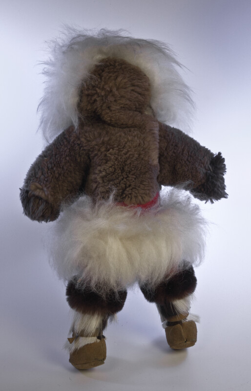 Nunavut, Canada First American Doll Wearing a Large Fur Parka and Boots with Beaded Trim (Back View)