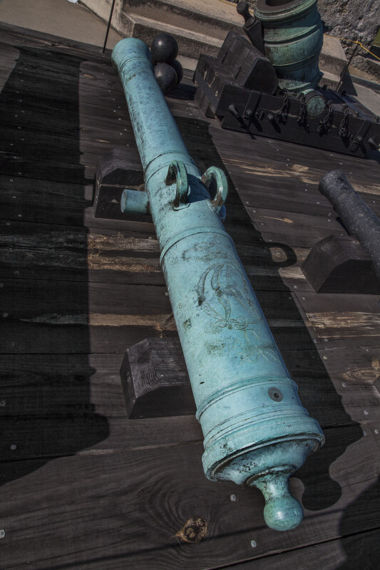 Oxidized, Bronze Cannon on a Wooden Deck at Castillo de San Marcos