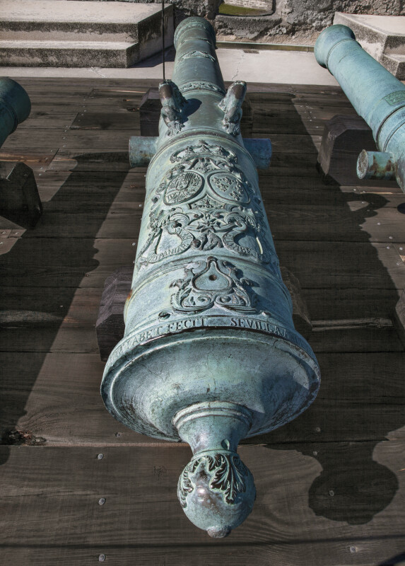 Oxidized Bronze Cannon with Many Carved Symbols and Letters