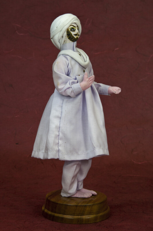 Pakistan Handcrafted Doll Made with Wire and Cloth (Three Quarter View)