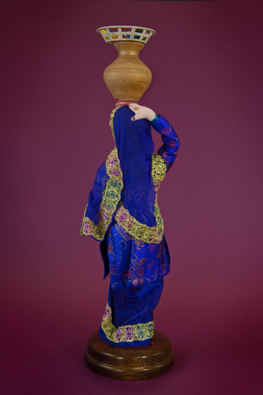 Pakistan Women Traditional Clothing with Water Jug on Head (Back View)