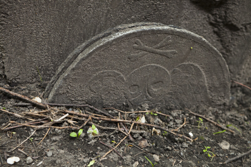 Part of a Headstone, with a Death's Head Carving