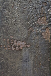 Patches of Rusted Metal under Black Paint