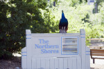 Peacock on Northern Shores Sign