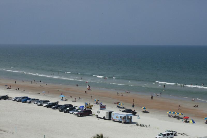 Peaople Walking and Swimming on Daytona Beach