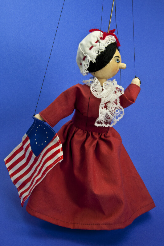 Pennsylvania Wood and Cloth Puppet with String Controls of Betsy Ross and Flag (Three Quarter View)