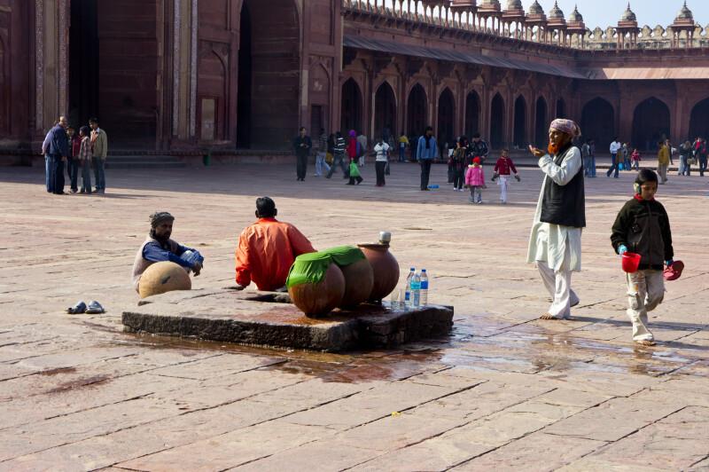 People Gather in the Quadrangular Courtyard