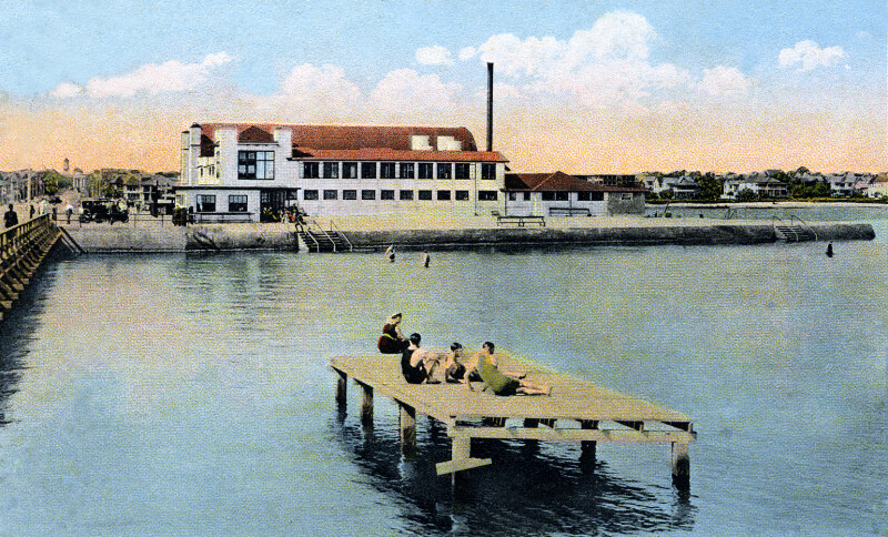 People Sitting on a Diving Platform in the Water near the Bathing Beach and Bath House in St. petersburg, Florida