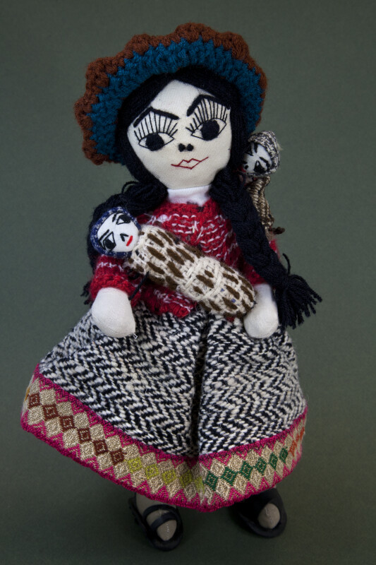 Peru Handcrafted Woman Holding A Baby with Another Baby Strapped to Her Back (Full View)