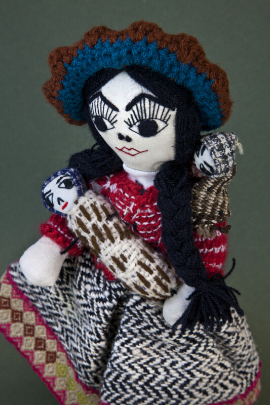 Peru Mother Doll Wearing Traditional Woven Dress with Two Babies Wrapped in Blankets (Three Quarter View)
