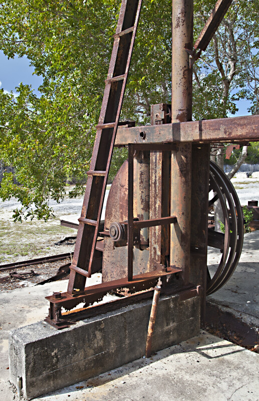 Poles and Wheel of a Rusted Machine at Windley Key Fossil Reef Geological State Park