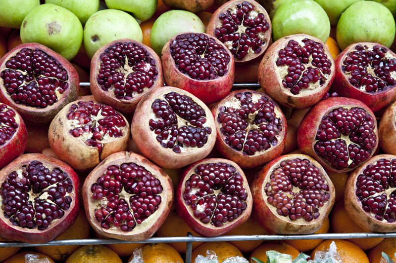 Pomegranates Stacked in a Row