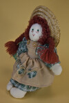 Prince Edward Island Anne of Green Gables Doll Wearing a Pinafore and Straw Hat (Three Quarter View)