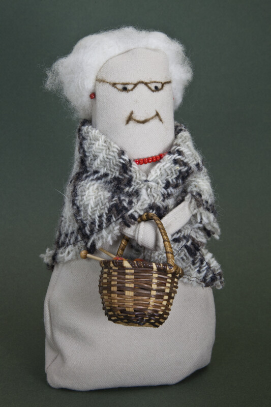 Prince Edward Island Female Doll Made with Fabric and Wool Holding a Straw Basket (Full View)