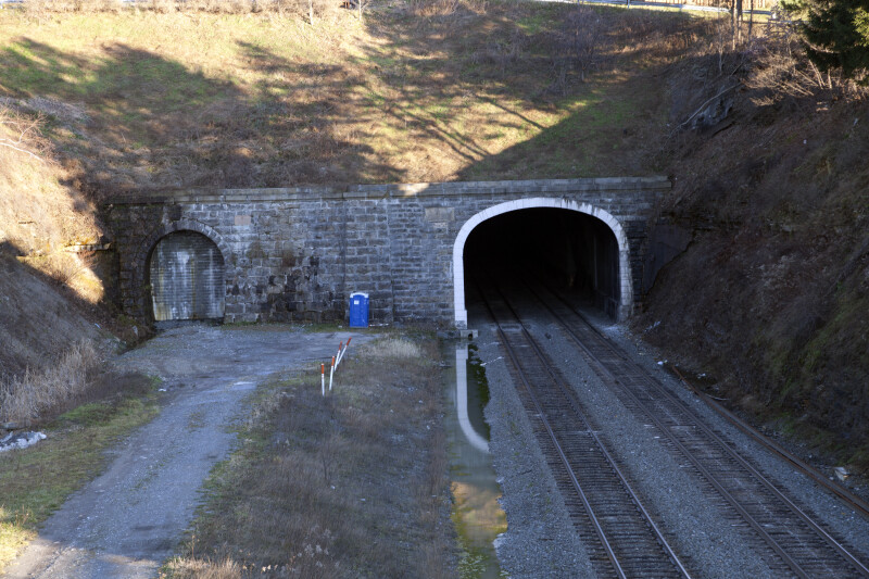 Railroad Tracks Running through a  Tunnel