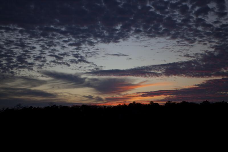 Reddish Clouds Near Horizon