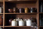 Redware and Stoneware on Shelves