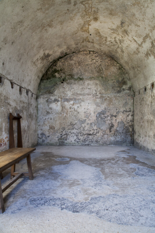 Room in Castillo de San Marcos with a Barrel Vault Ceiling and a Wooden Bench