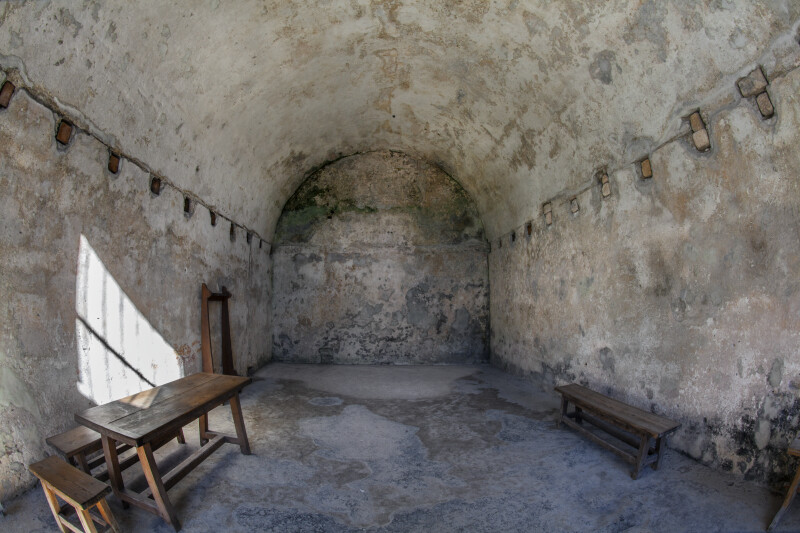 Room in Castillo de San Marcos with Wooden Benches and Stools