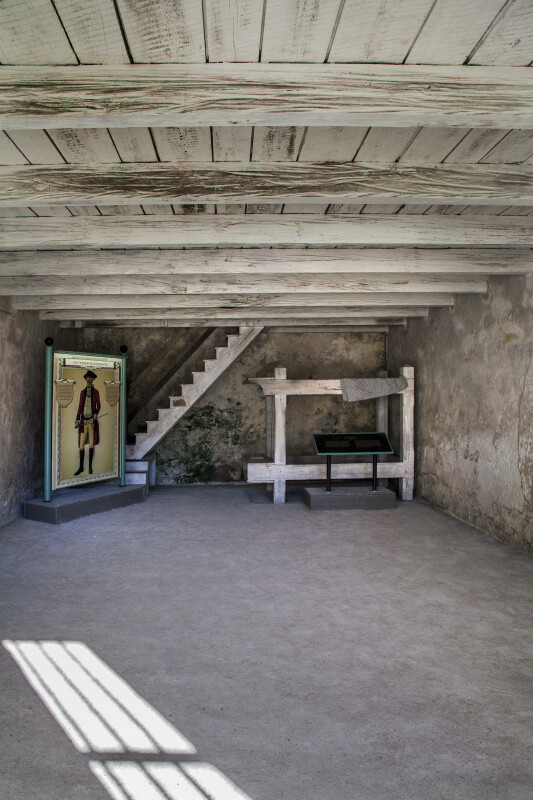 Room of the Castillo de San Marcos with a Wooden Ceiling and Stairs