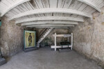 Room of the Castillo de San Marcos with Wooden Ceilings and a Staircase