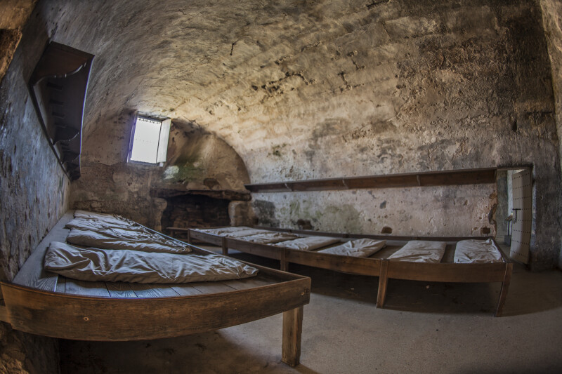 Room with Two Wooden Beds Adjacent to Entrance of Castillo de San Marcos