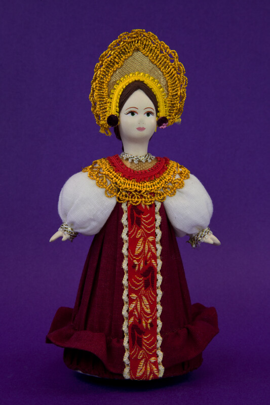 Russia Doll Dressed in Traditional Outfit with Brocade Trim and Headdress (Full View)
