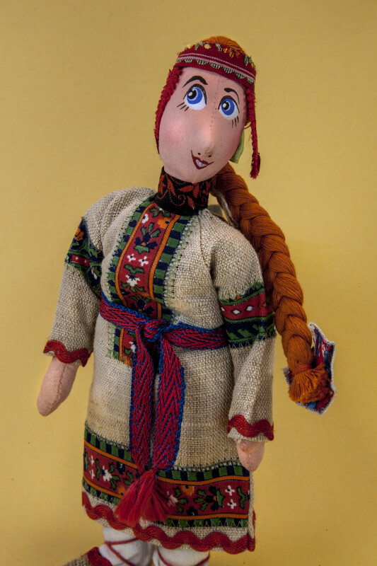 Russia Doll Wearing Burlap Dress with Brocade Trim and Burlap Slippers (Three Quarter View)