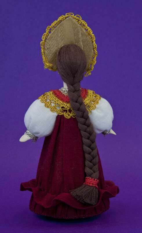 Russia Lady with Long Braid and National Costume (Back View)