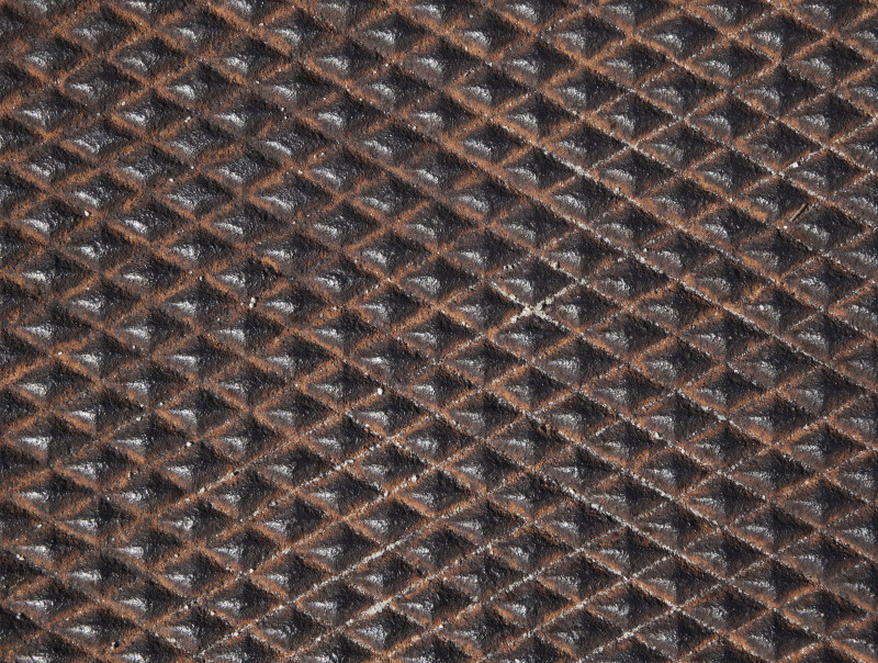Rusted Utility Cover with Diamond Pattern
